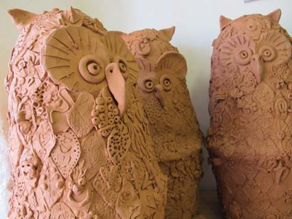 Pottery owls made by thousands of visitors to Eastnor Castle's pottery week hosted by jon the potter fromEastnor Pottery & the Flying Potter