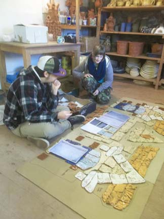 Eastnor Pottery staff check Catshill First School collaborative tile panel