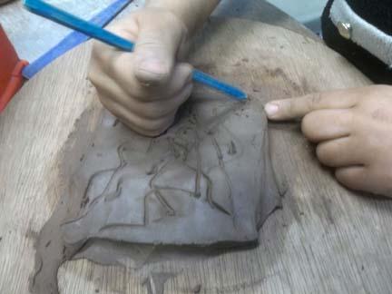 terracotta tiles made for outside mud kitchen