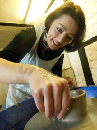Couples enjoy creative clay potter's wheel activity