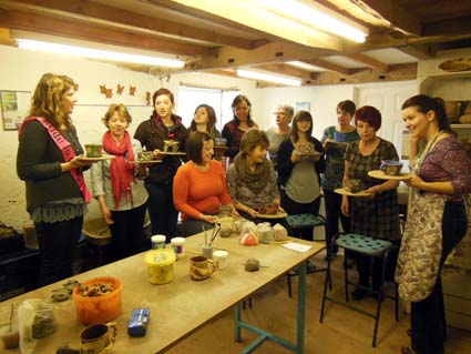Group of women make pottery as part of hen party celebration