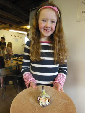 This young lady and her friends made and painted clay models and had lots of fun at Eastnor Pottery & The Flying Potter