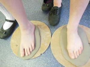 Children's footprints in clay at Castlemorton Primary School in Worcestershire