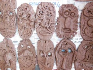 Clay masks made by YR2 at Leominster Infants school Herefordshire