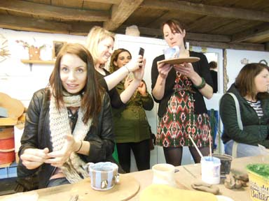 Hen party group enjoy making pottery at Eastnor Pottery Herefordshire