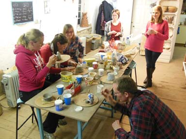 Group of teachers enjoy making pottery as an after school jolly