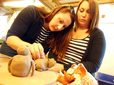 A couple of friends try make pottery at Eastnor Pottery