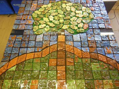 All the children in this Worcester Primary School each made a tile to form a composite image of the School logo.
