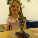 Clay banana made by girl at her pottery birthday party at Eastnor Pottery