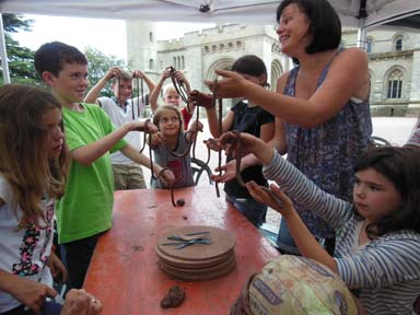Castle visitors indulge in some collaborative clay fun in the Castle Courtyard with the Flying Potter