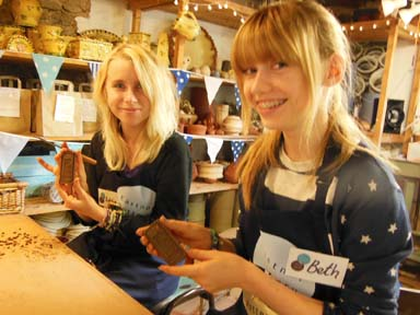 Lottie & Beth start production of the clay mud runner medals
