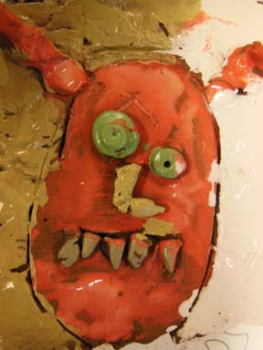 Pottery monster tile made by YR3 student at Bishops Cleeve Primary School nr Cheltenham