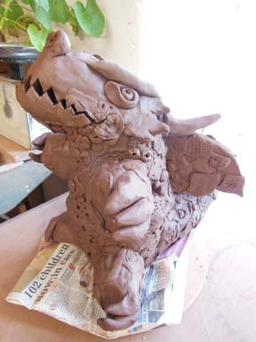 Each child in class 3/4 made several dragon scales as a creative contribution to this collaborative clay dragon