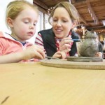 creative activity for February 1/2 term family making clay models at Eastnor Pottery