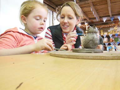 creative activity at Christmas time family making clay models at Eastnor Pottery