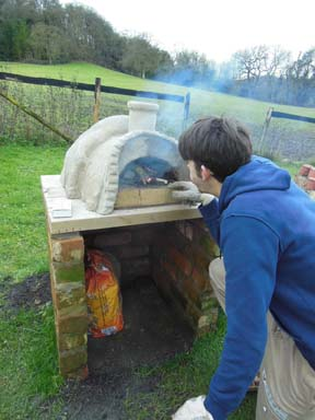 Clay pizza oven built in the garden at Eastnor Pottery