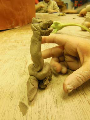 clay dinosaur made by child at Washwood Heath Nursery School