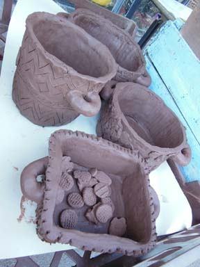 Collaborative clay cooking pots made by children at Brearley and Teviot Nursery School in Brum