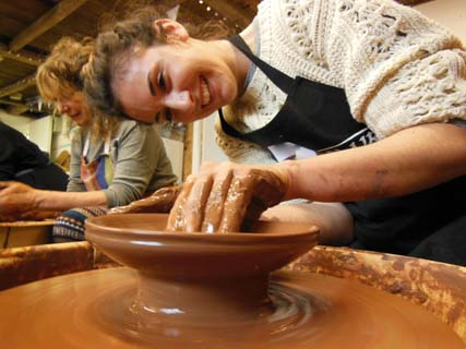 Beginner learning how to make pottery at Eastnor Pottery in Herefordshire