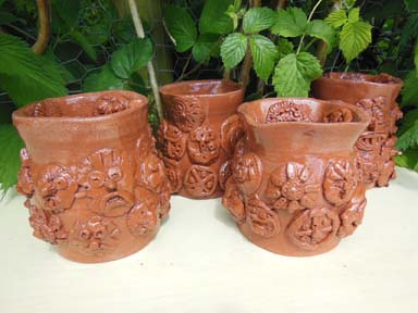 Collaborative terracotta wheel thrown pots made at Kings Hawford School Worcester