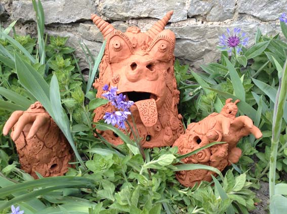 Terracotta beastie made by families at the opening event at The Masters House Ledbury Herefordshire workshops led by potters Sarah and Lottie from Eastnor Pottery
