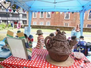 Eastnor Pottery work with families to create celebratory tea set at Ledbury Poetry Festival