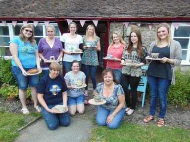 Hen party outside sunny Eastnor Pottery