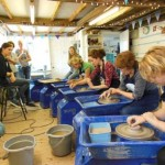 all the hens having a go with the potter's wheel