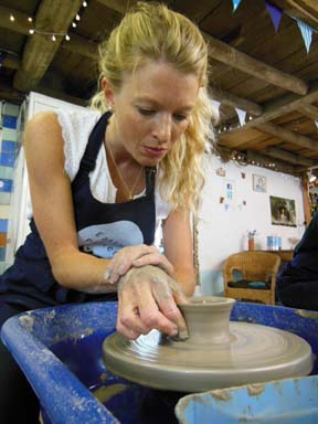 Careful hands on the potter's wheel
