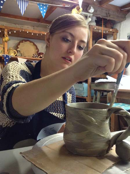 Slip painting on to great mug at Eastnor Pottery