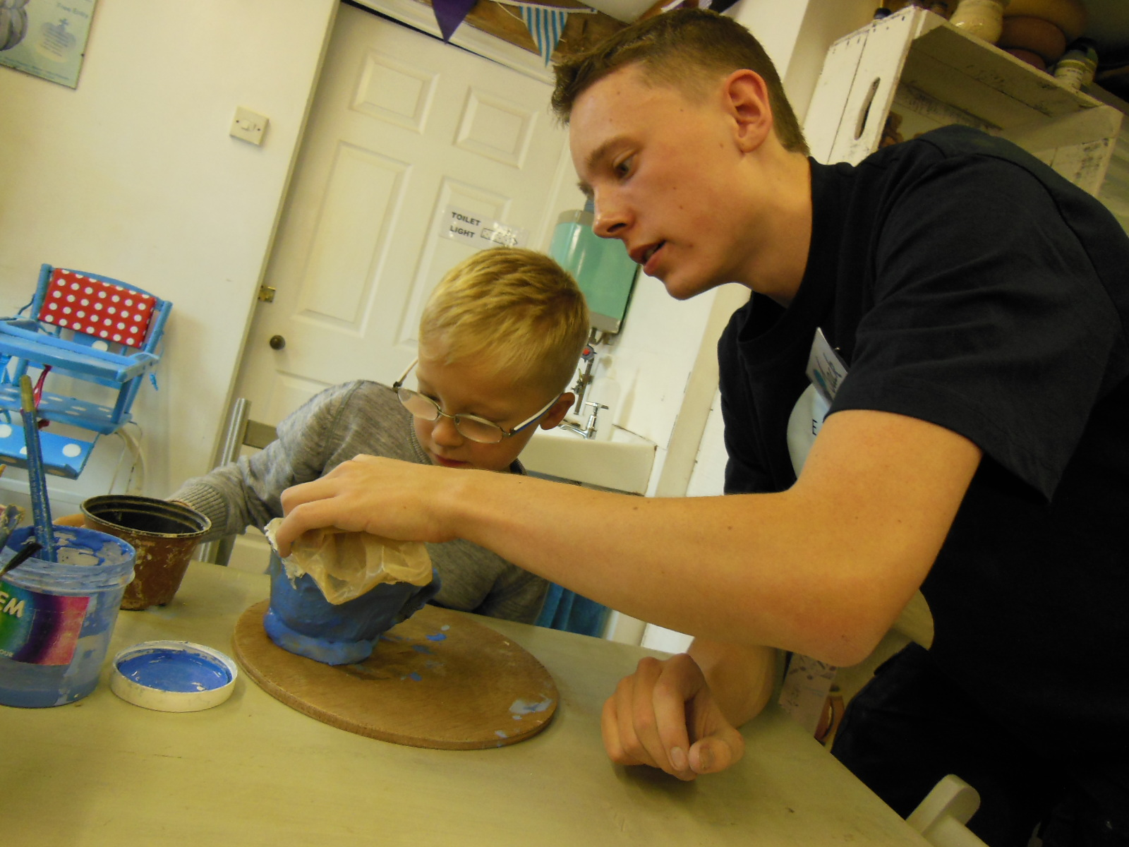 digital apprentice Jack gets hands on with clay with a young pottery customer