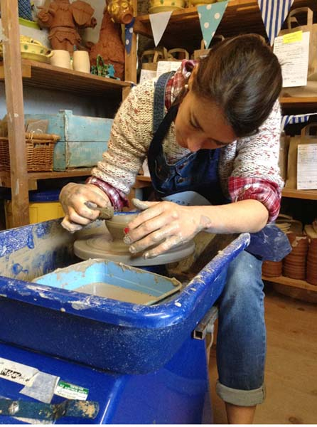 Steady hands on the potter's wheel at Eastnor Pottery