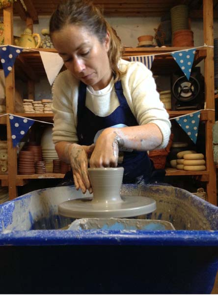 Careful hands on the potter's wheel at Eastnor Pottery