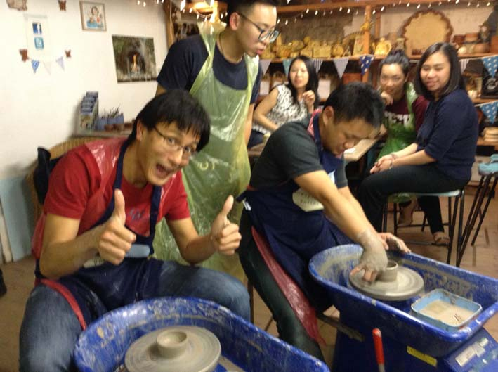 Having fun on the Potter's Wheel at Eastnor Pottery