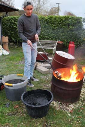 Ethan firing pots in Raku style