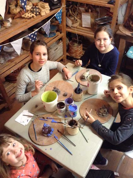 Colourful cats and dogs made at Eastnor Pottery's Children's Halfterm workshop