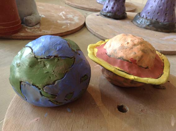 Customers of Eastnor Pottery make Pottery Planets during halfterm break