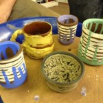 painted clay pots made on the potter's wheel by a beginner