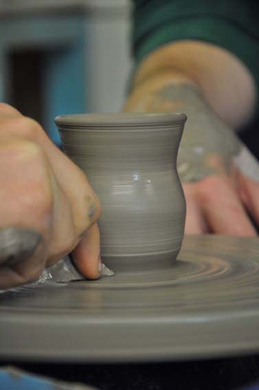 freshly hand thrown pot made on the potter's wheel