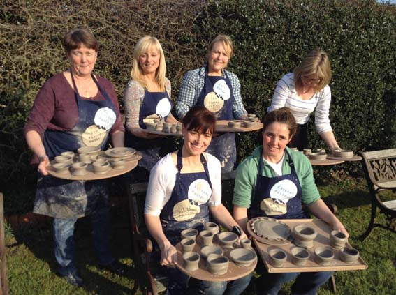 Learning to throw on the Potter's Wheel at Eastnor Pottery for 50th Birthday