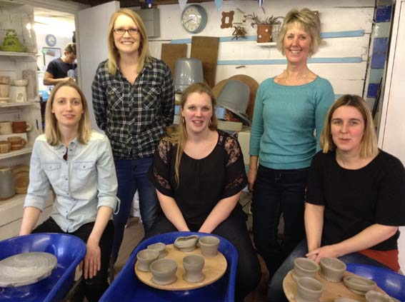 Hens having a go on the Potter's Wheel at Eastnor Pottery