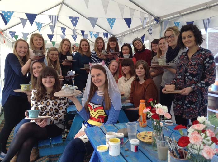 Hen party coil pots and their makers in the Potting Tent at Eastnor Pottery
