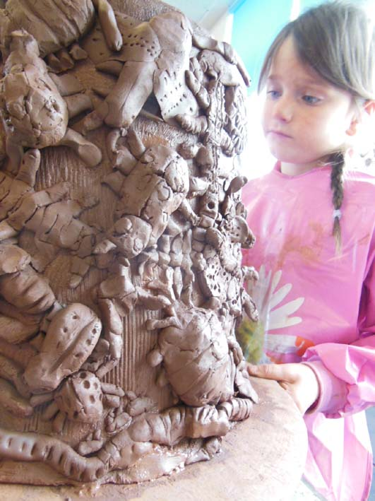Eastnor Pottery at Bishops Cleeve Primary School making giant terracotta planters