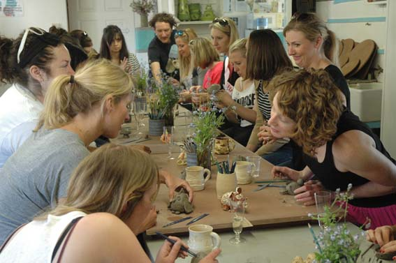 Hen party group at Eastnor Pottery making pinch pot animals