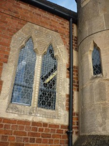 Model window at Malvern parish for ceramic stained glass window tile panels made with Eastnor Pottery