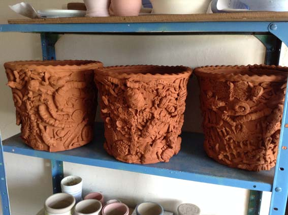 Terracotta planters made at Bishops Cleeve Primary School with Eastnor Pottery and the Flying Potter