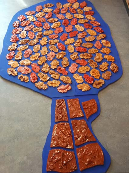 Holyoaks Primary School in Redditch worked with Eastnor pottery and the Flying Potter to make tree shaped tile panel
