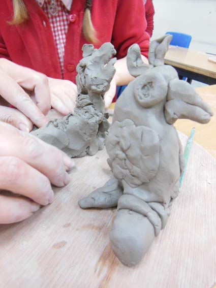 Clay Parrots being made with Jon the Flying Potter from Eastnor Pottery