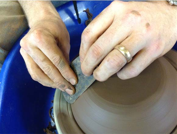 Weekend Workshop participants learning to turn on potter's wheel at Eastnor Pottery