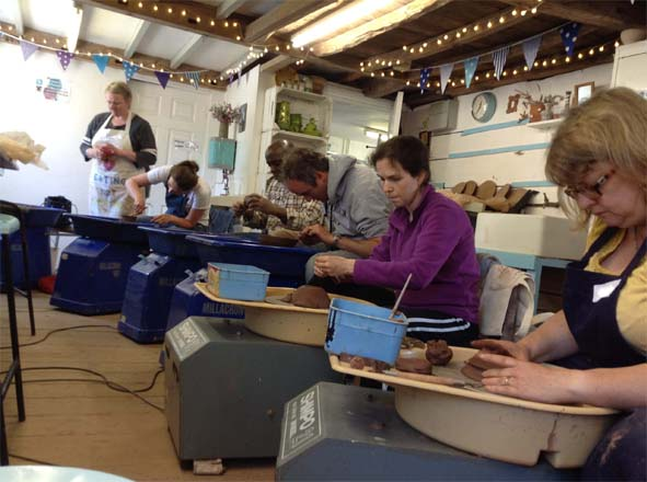 Potter's Wheel Workshop Participants at Eastnor Pottery perfecting their thrown creations